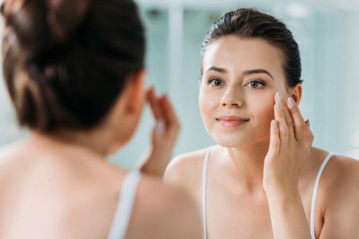 woman mirror face wrinkle cream
