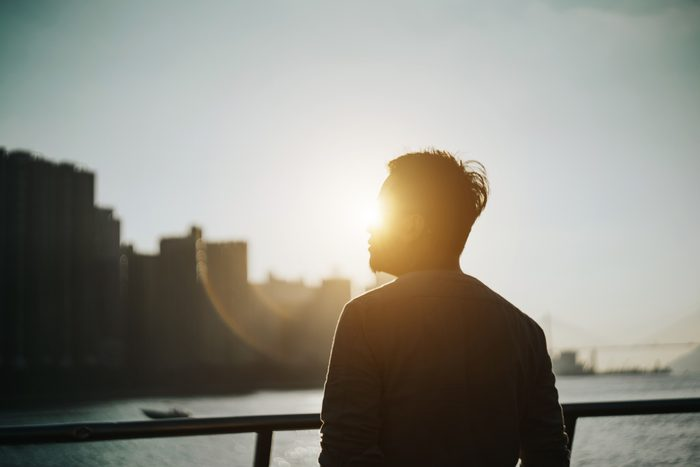 silhouette of a man outside during susnet