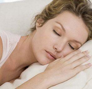 essential guide to deeper sleep woman sleeping