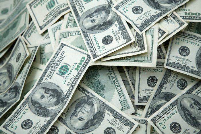 pile of hundred dollar bills full frame shot