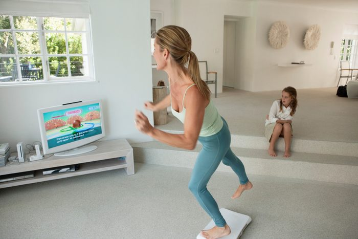 woman playing exercise video game on tv