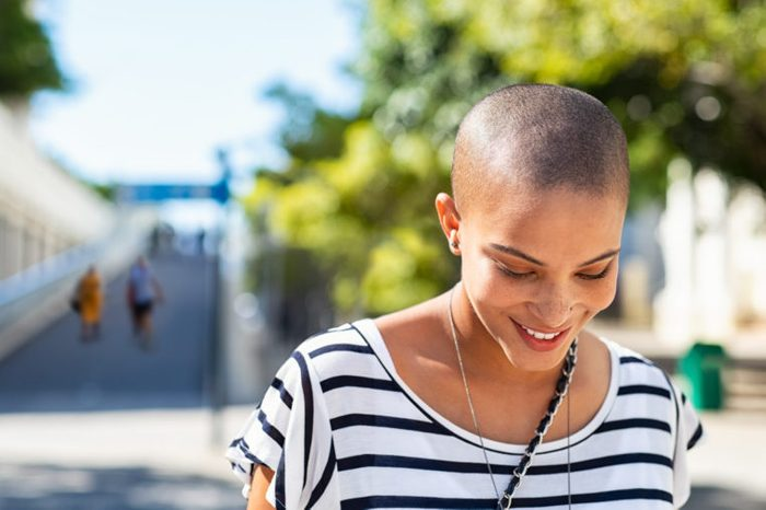 woman smiling and walking outdoors