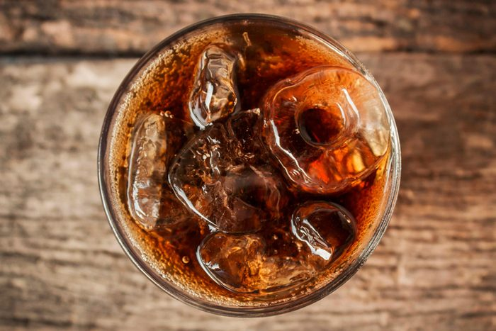 Overhead view of glass of cola with ice