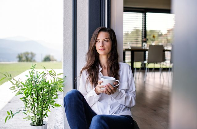 woman relaxed and happy sitting at home
