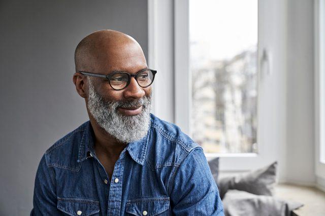 mature man smiling and thinking