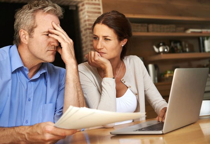 husband and wife discussing medical bill at home