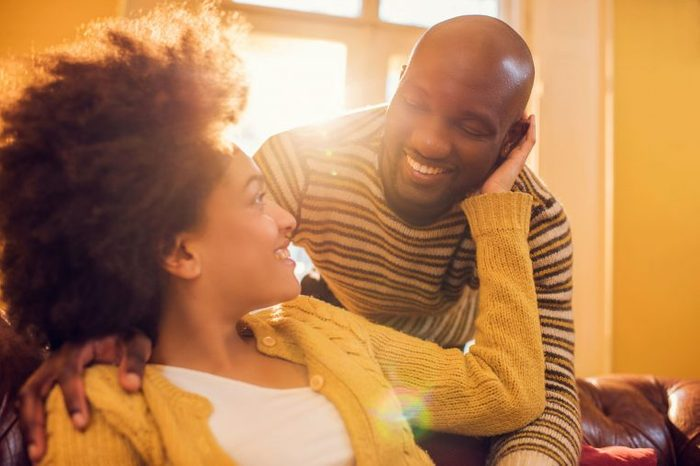 black couple holding and looking at each other with affection