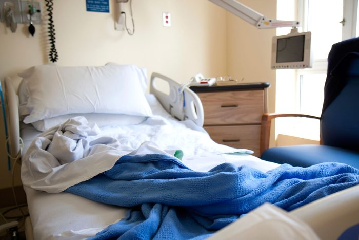 unmade empty hospital bed