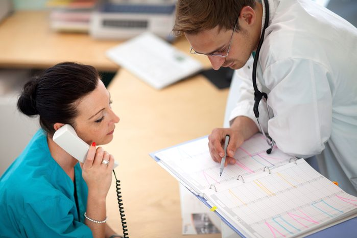 nurse and doctor discussing schedule