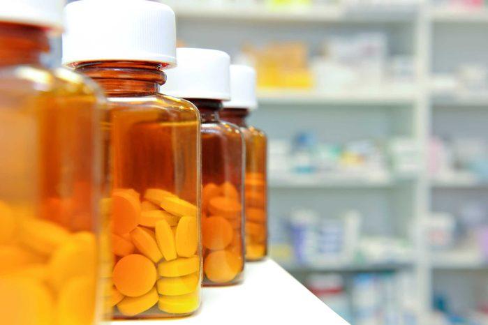bottles of pills in a pharmacy