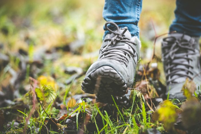 close up of hiking boots on a trail