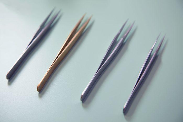 four pairs of tweezers