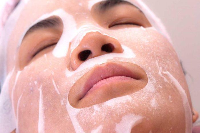 woman getting facial peel