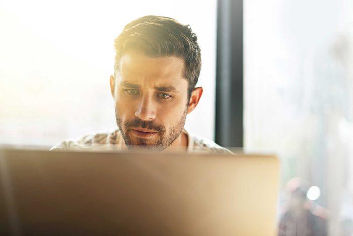 Man looking at computer screen just below eye level.