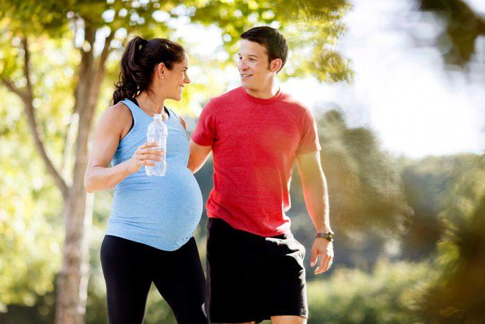 man and pregnant woman walking