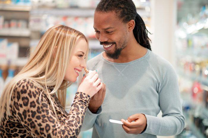 couple shopping for perfume fragrance