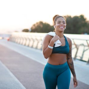 woman walking for exercise and smiling