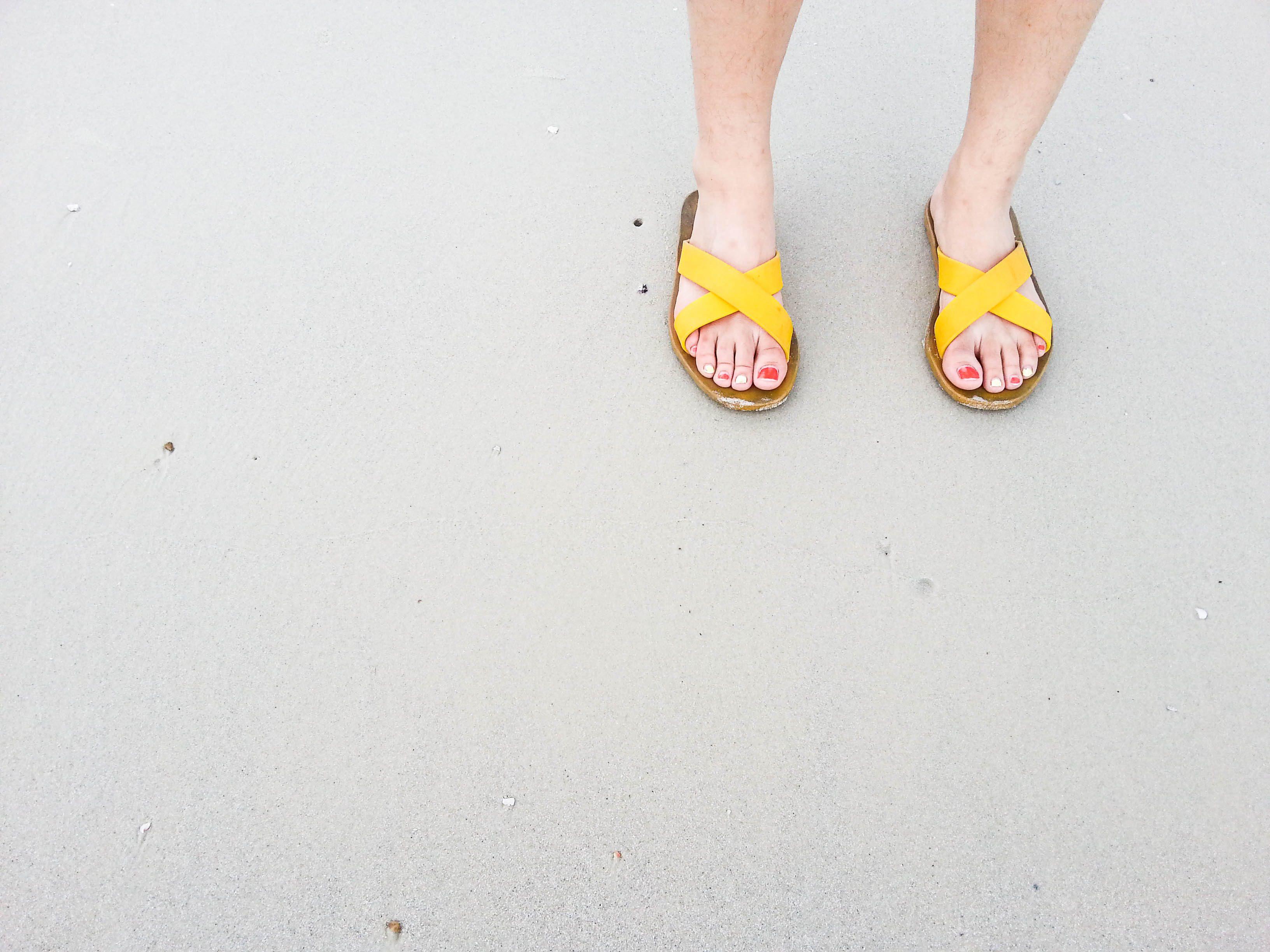 woman wearing yellow sandals
