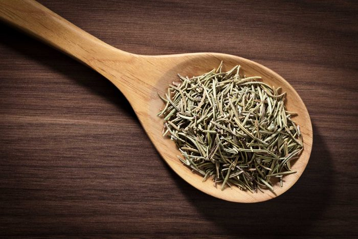 dried rosemary on spoon