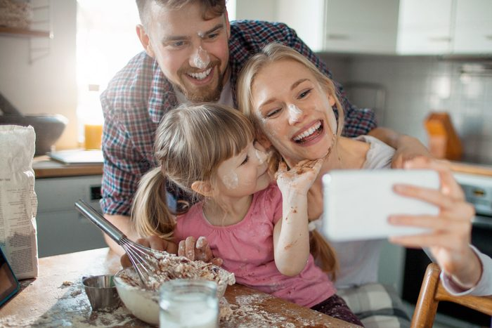 messy family taking selfie
