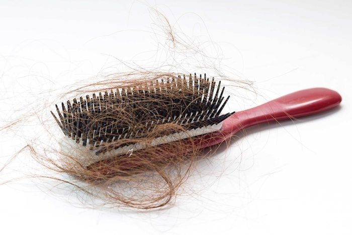 hair brush with lots of hair in it