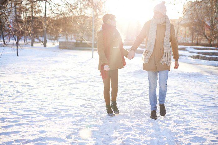 couple walking in snow
