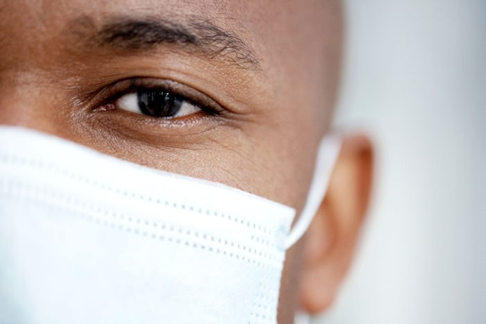 closeup of man in surgical mask