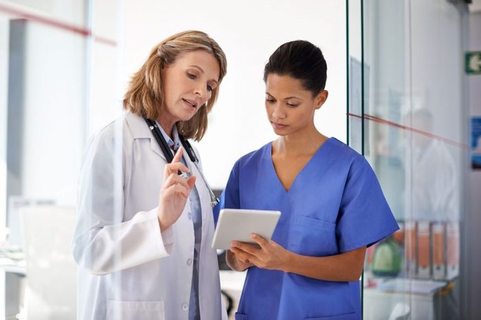 Healthcare workers looking at notes