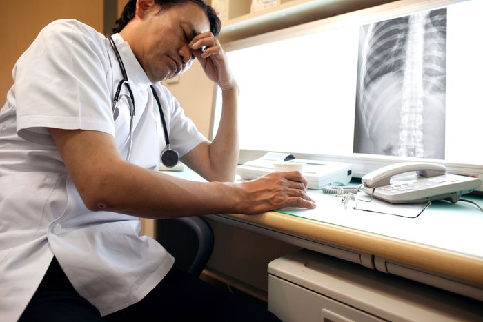 unhappy healthcare worker looking at chest X-ray