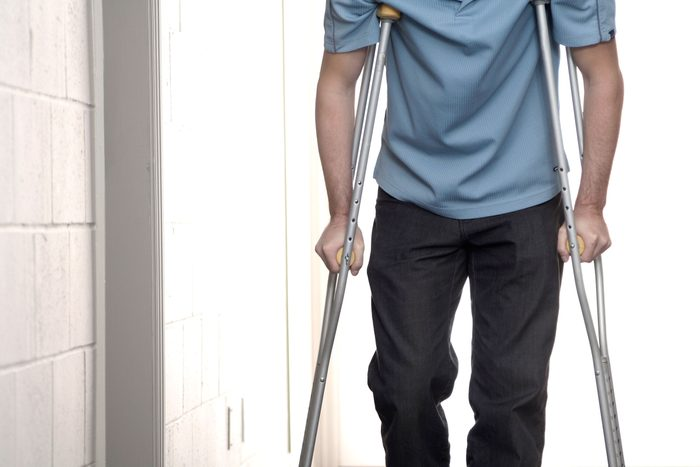 person wallking on crutches