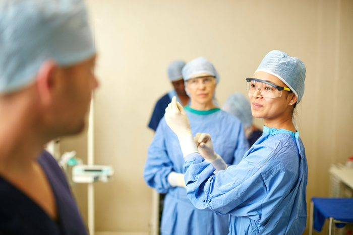 surgeons wearing surgical gear