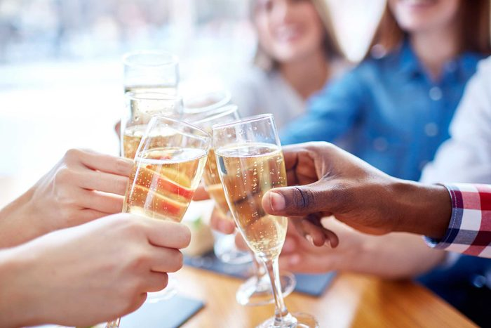 people toasting with flutes of champagne