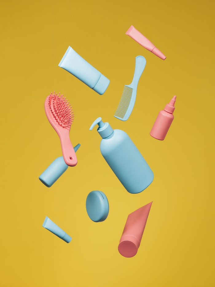beauty products on yellow background
