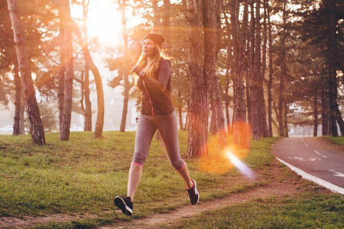 woman walking briskly outdoors