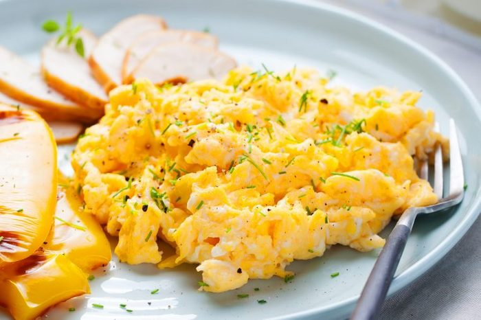 Plate of soft scrambled eggs.