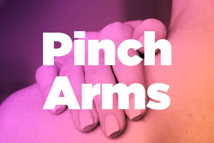 """Words """"pinch arms"""" over image of hands rubbing shoulder"""