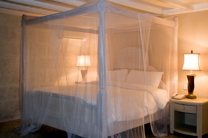 mosquito net canopy over bed