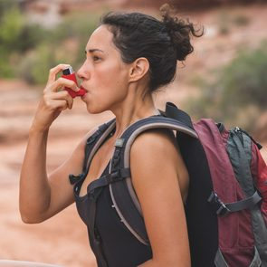 asthma inhaler woman hiking