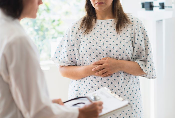cropped shot of woman talking to doctor