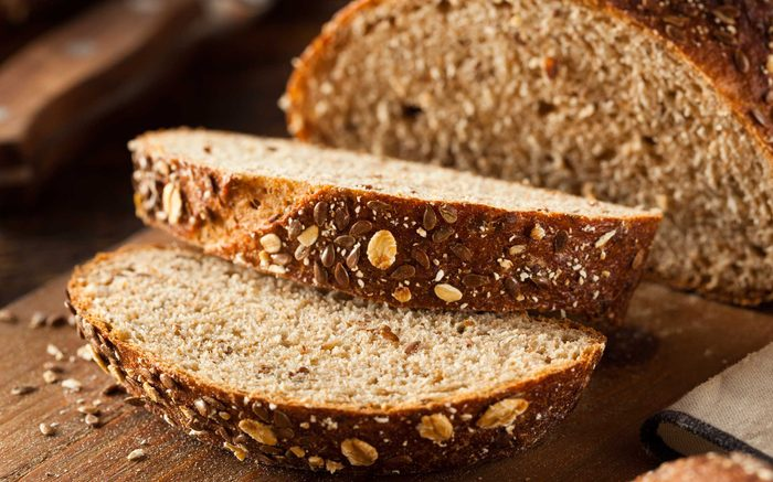 two slices cut from loaf of brown bread