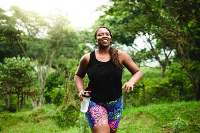 woman walking and exercising in nature