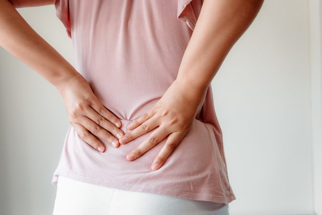 woman experiencing lower back pain