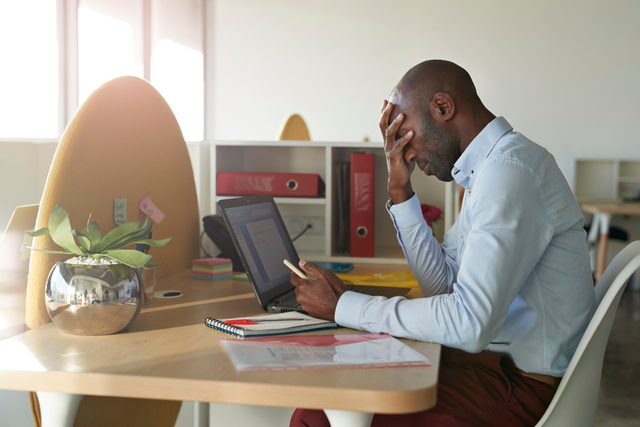 man stressed out from work