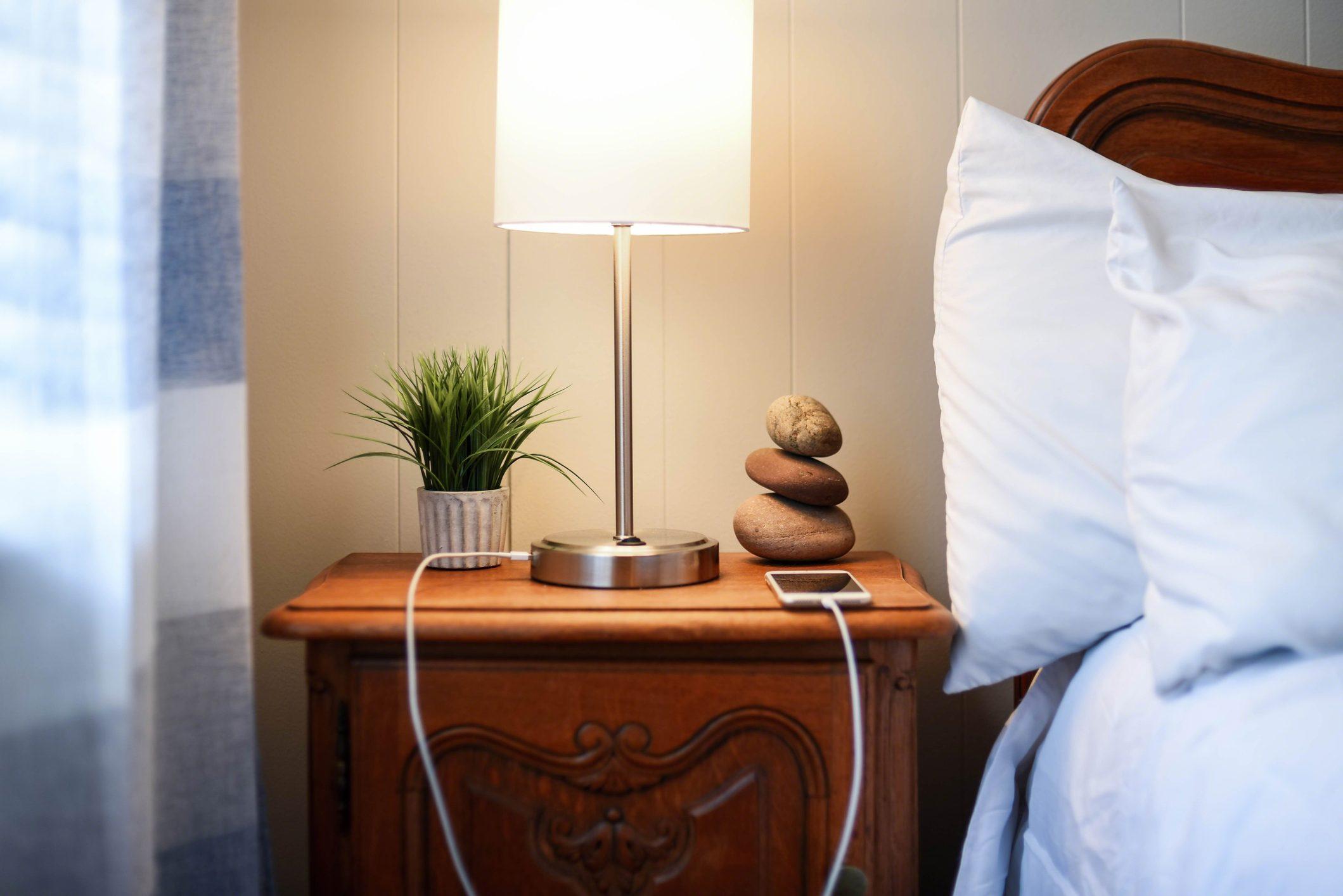 smarphone charging on nightstand