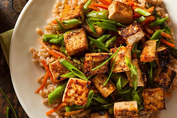 a tofu and vegetable stir fry over brown rice