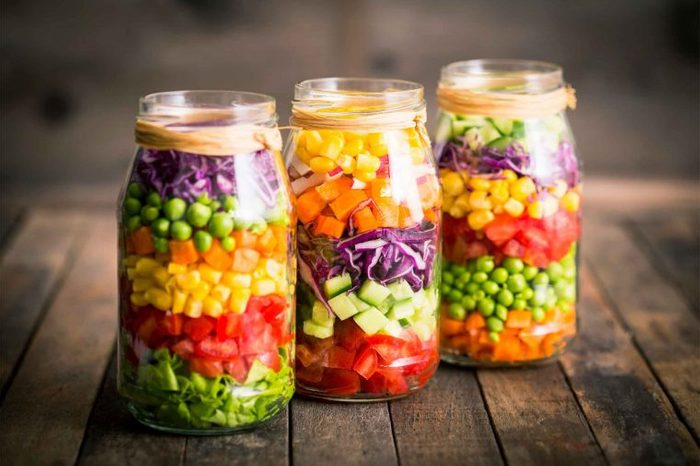 jars with layered chopped produce