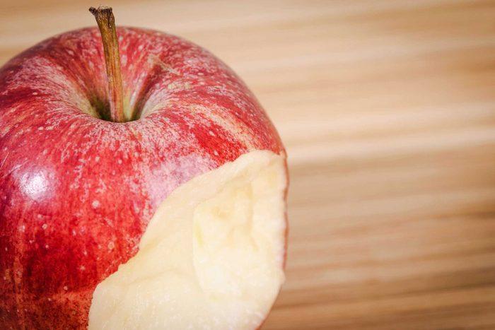 half-eaten red apple