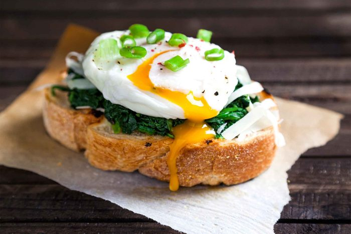 Toast with eggs, spinach, and green onions