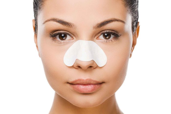 woman with nasal strip on nose