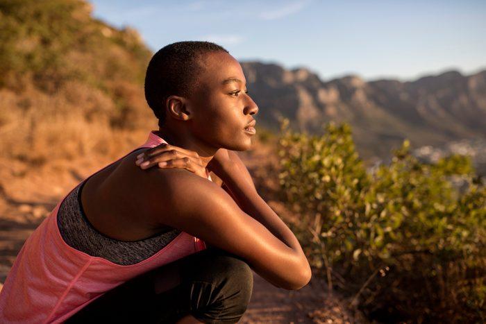 woman taking a break while hiking